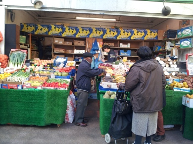 Brixtonians buying fresh veg & fruit in Granville Arcade